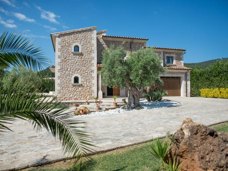 fachada: Casas de estilo rural de Diego Cuttone - Arquitecto