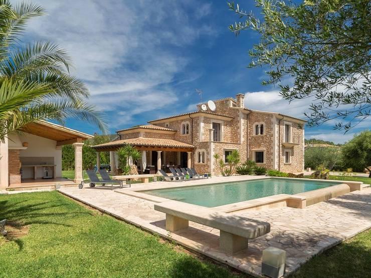 Exterior de la casa: Casas unifamilares de estilo  de Diego Cuttone - Arquitecto