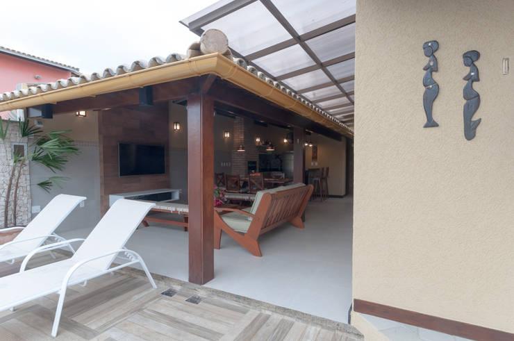 Espaço gourmet integrado: Condomínios  por Bernal Projetos - Arquitetos em Salvador