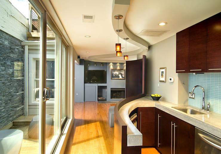 D Street: modern Kitchen by KUBE Architecture