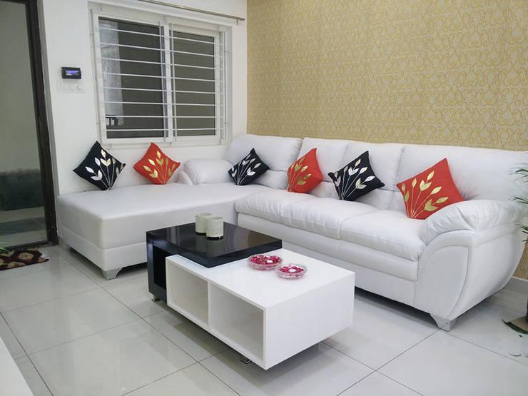 Mr Surajit Aparna cyberzone 3bhk :  Living room by Enrich Interiors & Decors