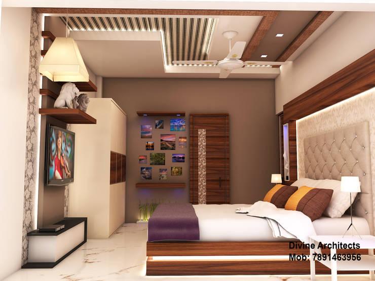 Son_ s bed room interior design for mr. Ramavtar Khunteta jalmahal site joraver Singh gate govind nagar east Jaipur:  Bedroom by divine architects