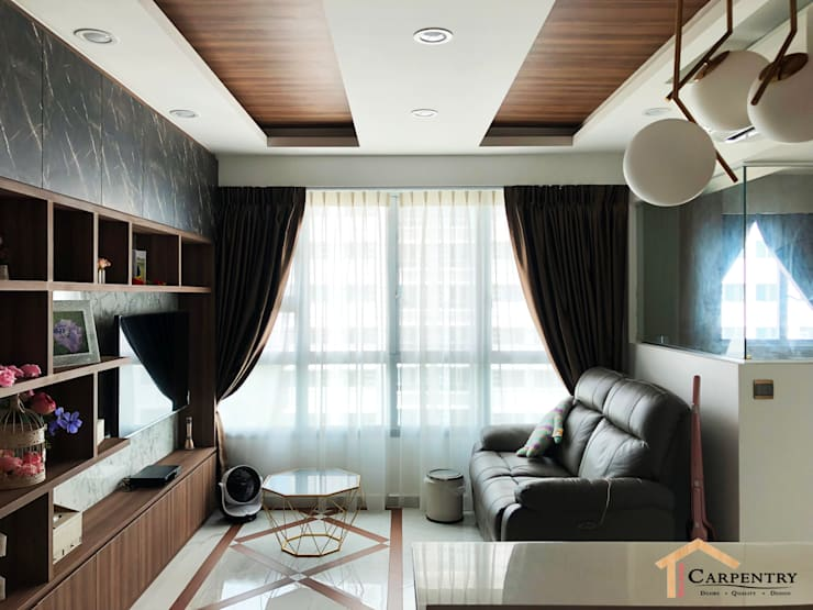 Contemporary style at Tenteram Peak:  Living room by Singapore Carpentry Interior Design Pte Ltd