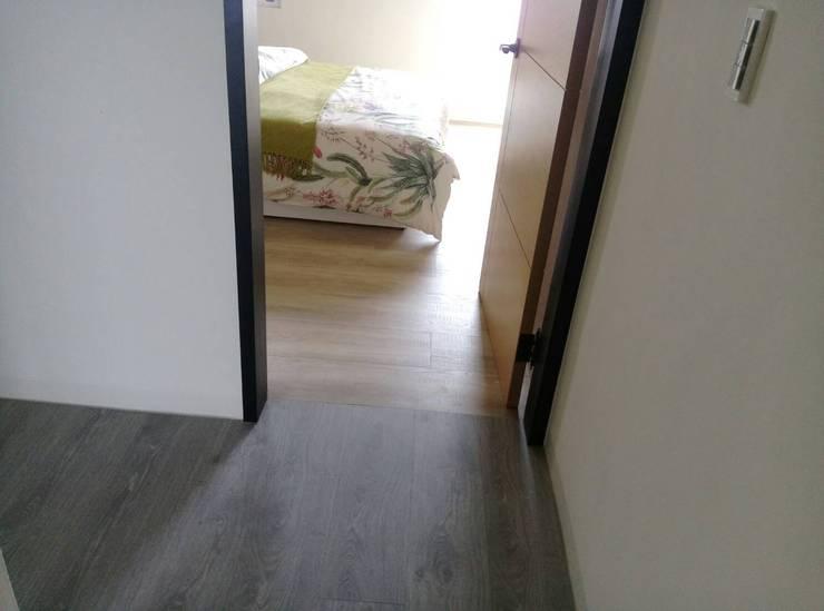 北成路:  臥室 by 昇揚木地板