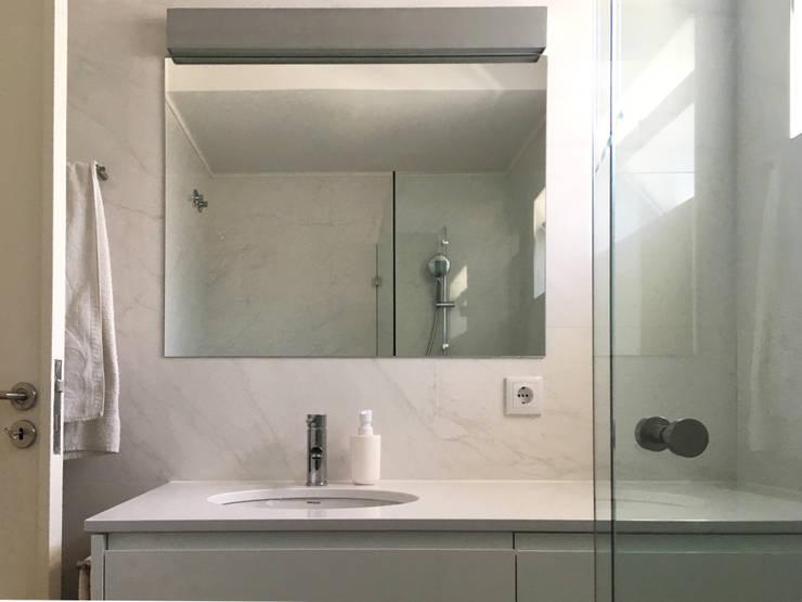 Banheiros modernos por GAAPE - ARQUITECTURA, PLANEAMENTO E ENGENHARIA, LDA Moderno