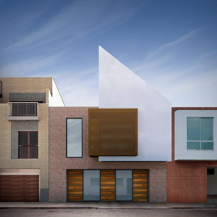 Fachada casa Santa Anita: Casas unifamiliares de estilo  por Punto De Fuga Arquitectura, Moderno Ladrillos