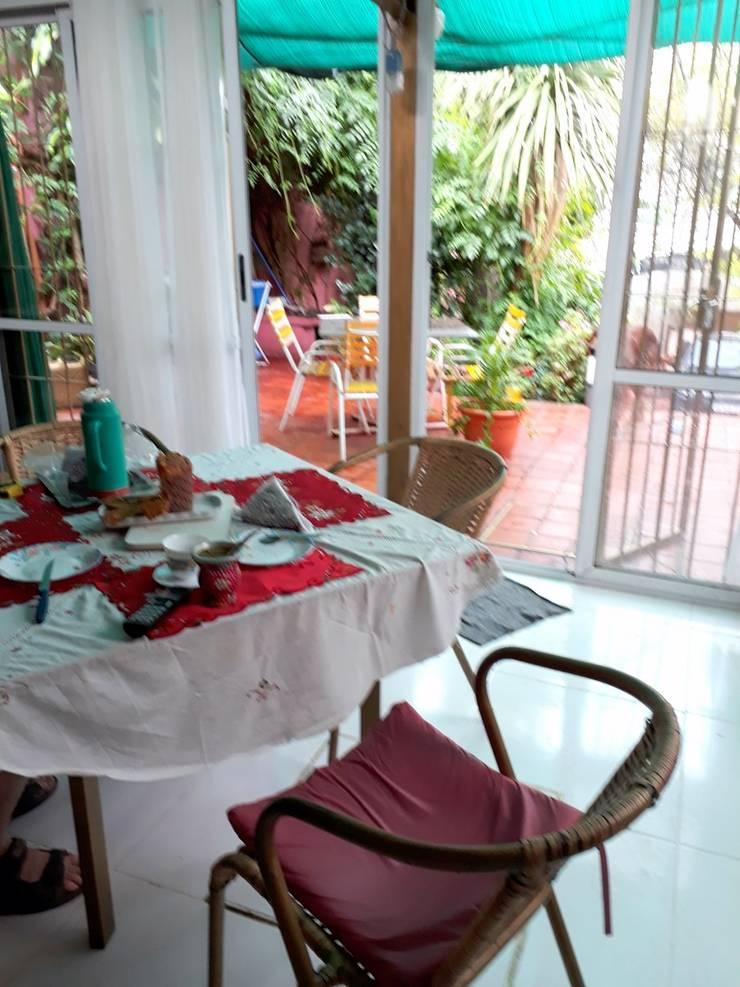 Integracion paisajistica del patio con el interior :  de estilo  por Arq.SusanaCruz