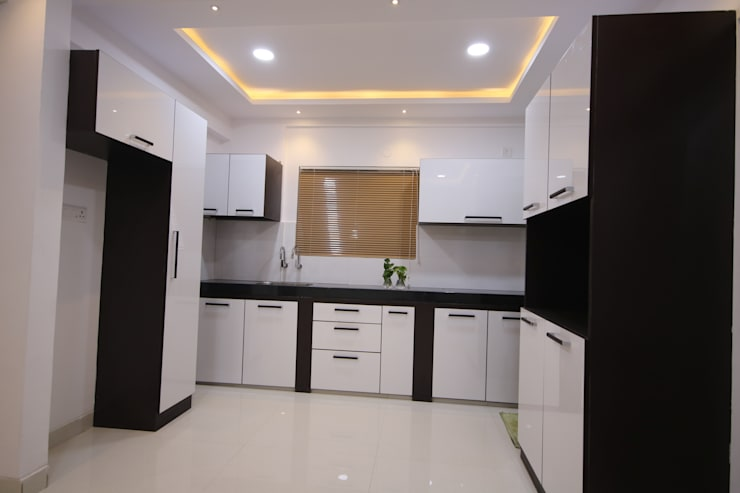 Begonia Homes | 2BHK | Semi Furnished Home:  Kitchen units by Enrich Interiors & Decors