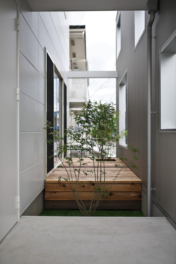 Jardin rustique par ALTS DESIGN OFFICE Rustique