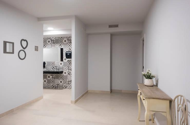 Casa de banho - Design Interiores café pastelaria: Espaços de restauração  por Oficina Design