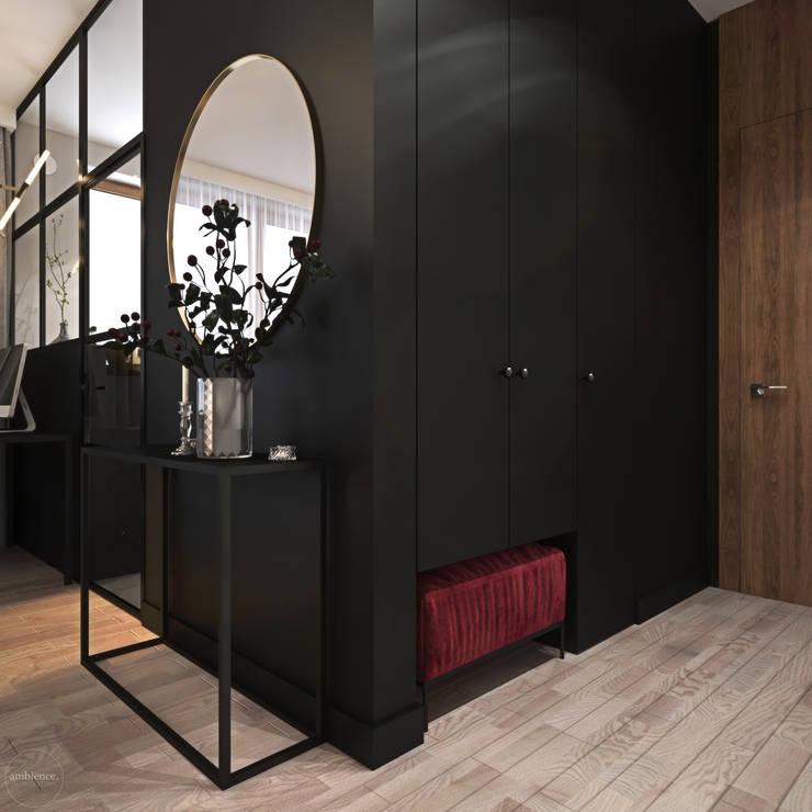 Odważne mieszkanie z czerwienią: styl , w kategorii Korytarz, przedpokój zaprojektowany przez Ambience. Interior Design,