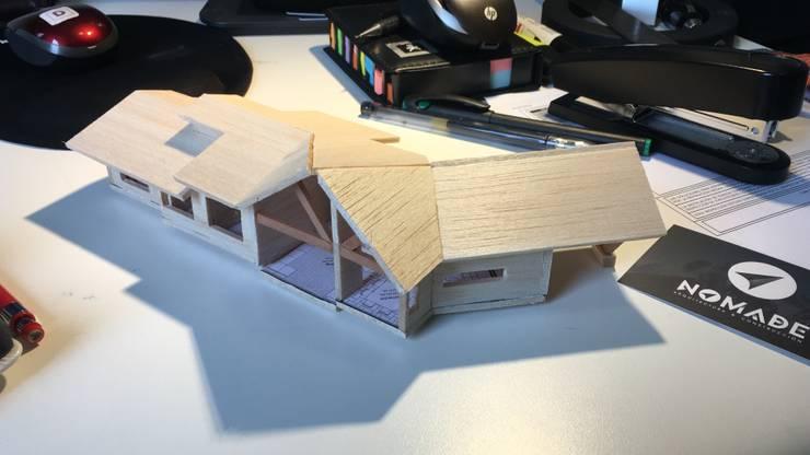 Vivienda F B:  de estilo  por Nomade Arquitectura y Construcción spa