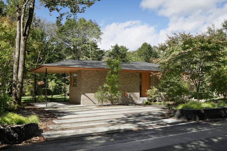 Casas de campo de estilo  por atelier137 ARCHITECTURAL DESIGN OFFICE,