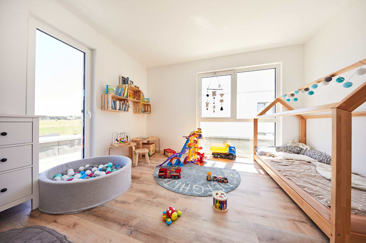 Nursery/kid's room by STRICK  Architekten + Ingenieure, Modern