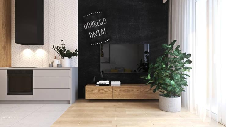 Ciepłe mieszkanie w nowoczesnym stylu: styl , w kategorii Salon zaprojektowany przez Ambience. Interior Design