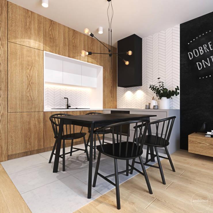Ciepłe mieszkanie w nowoczesnym stylu: styl , w kategorii Kuchnia zaprojektowany przez Ambience. Interior Design