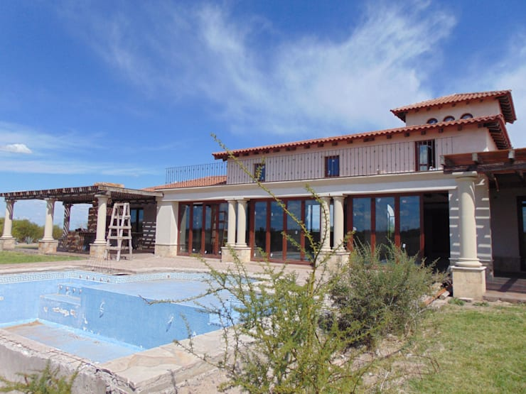 Vivienda en Algodon - Lote E26: Casas de campo de estilo  por Azcona Vega Arquitectos