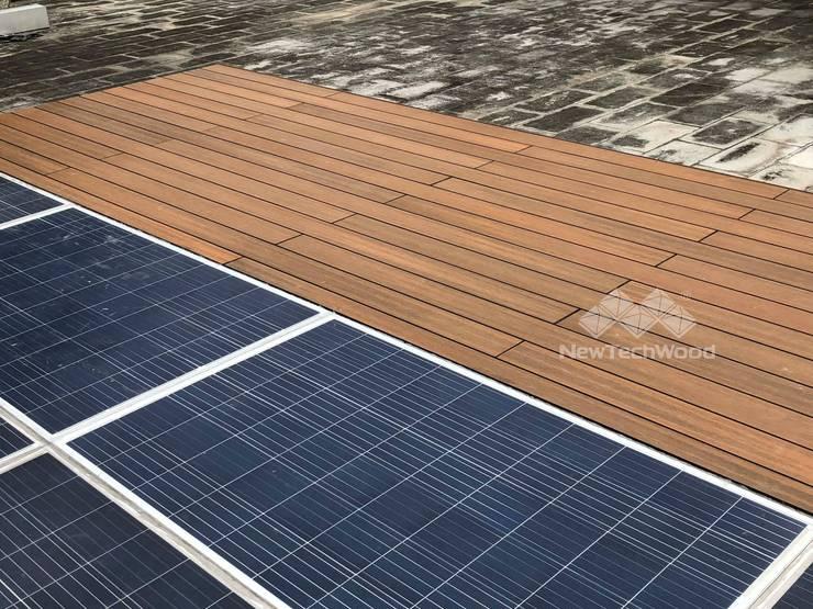 石門水庫─太陽能板平台與柚木平台:  平屋頂 by 新綠境實業有限公司