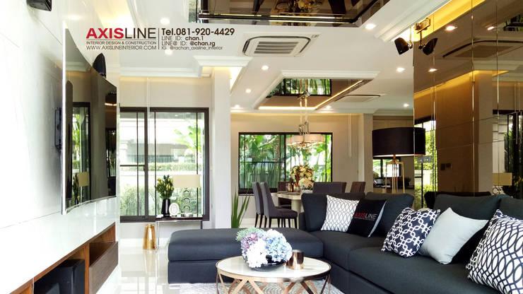 Living room (ห้องนั่งเล่น):  ตกแต่งภายใน by บริษัทแอคซิสลาย จำกัด