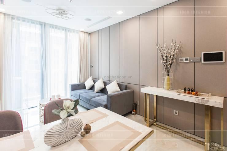 Thi công nội thất căn hộ Aqua 1 Vinhomes Golden River - Phong cách hiện đại:  Phòng khách by ICON INTERIOR