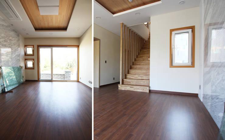 주택 내부: 더존하우징의  거실,모던