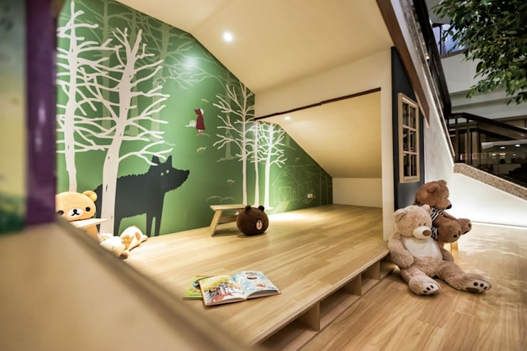充滿童趣的兒童休憩與閱讀區域:  活動場地 by 青易國際設計