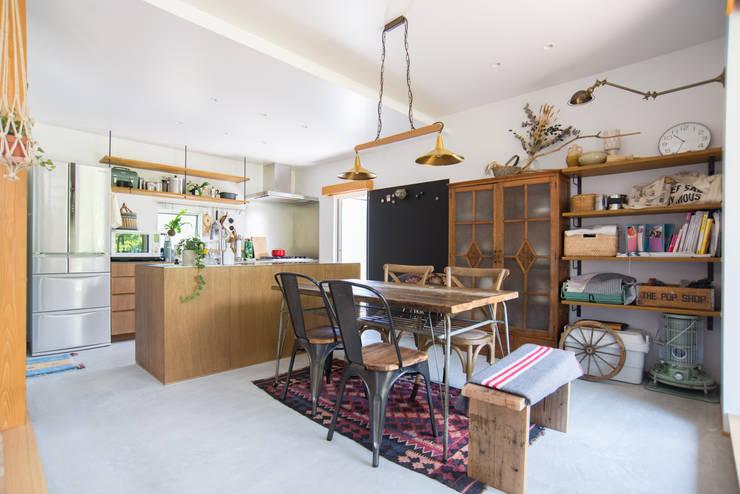 土間キッチンの家 house_in_nishiyama: タイラ ヤスヒロ建築設計事務所/yasuhiro taira architects & associatesが手掛けたダイニングです。