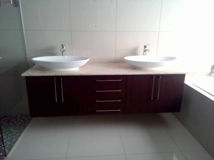 Floating Vanity:  Bathroom by Universal Kitchens & Granite