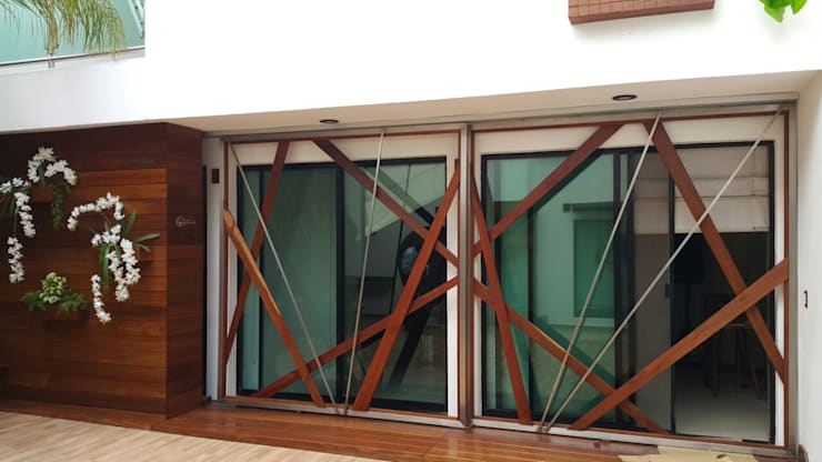 Madera: Balcones y terrazas de estilo  por Arquitectura Orgánica Viviana Font