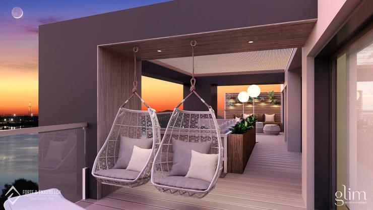 TERRAÇO DECORADO: Varanda, marquise e terraço  por Glim - Design de Interiores