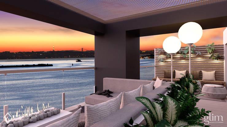 TERRAÇO MOBILADO: Varanda, marquise e terraço  por Glim - Design de Interiores