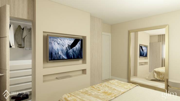 PAREDE PARA TELEVISÃO NO QUARTO: Quarto  por Glim - Design de Interiores