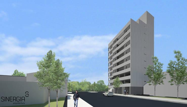Fachada Edificio vista sur: Condominios de estilo  por SINERGIA ARQUITECTURA,