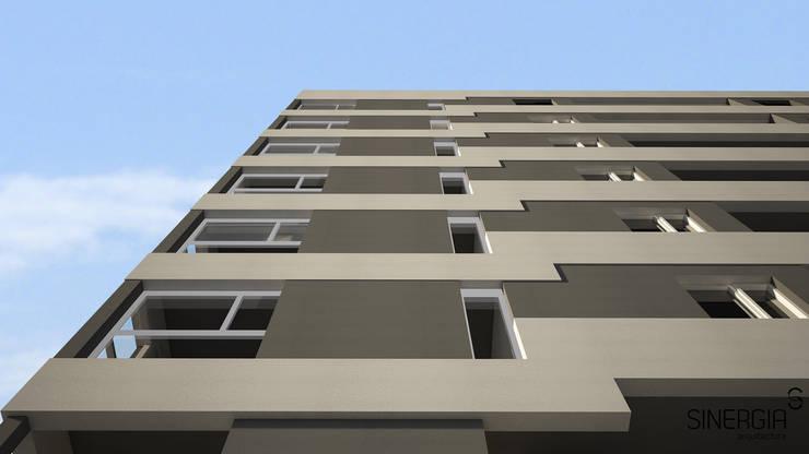 Fachada cerramiento: Condominios de estilo  por SINERGIA ARQUITECTURA,