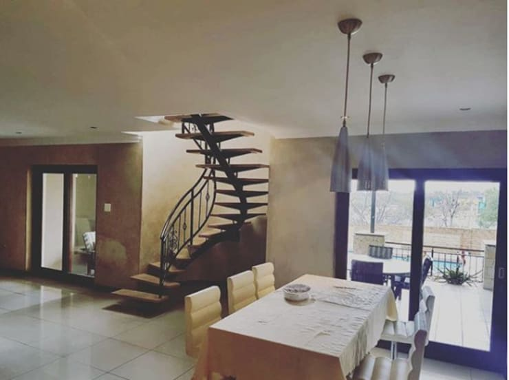Spiral Staircase:  Stairs by TOP CENTRE PROPERTIES GROUP (PTY) LTD