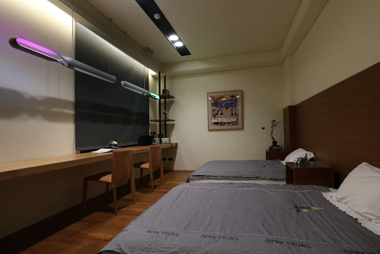 美術南五街:  臥室 by 雅群空間設計
