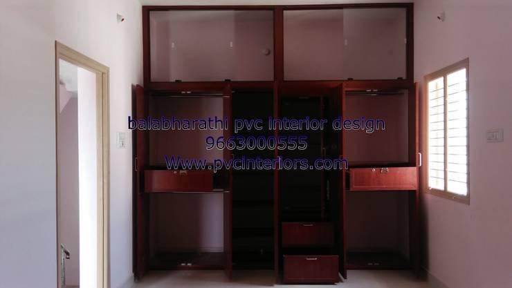 pvc bedroom wardrobe in trichy:  Bedroom by balabharathi pvc interior design
