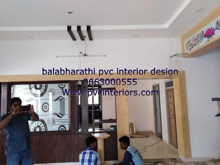 pvc hall decoration 9663000555:  Living room by balabharathi pvc interior design