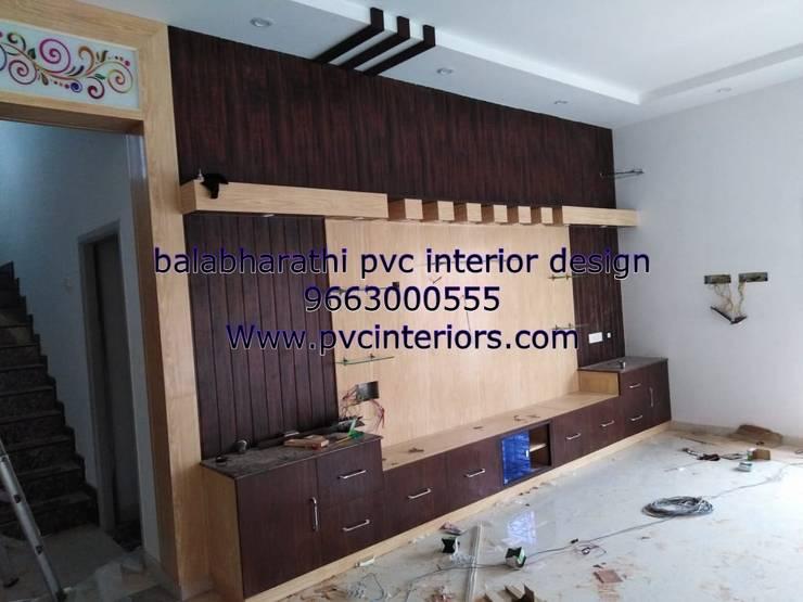 pvc tv showcase in trichy 9663000555:  Living room by balabharathi pvc interior design