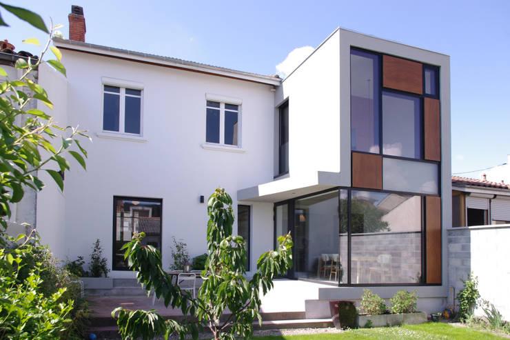 Extension d'une maison de ville : Maison individuelle de style  par Créateurs d'interieur