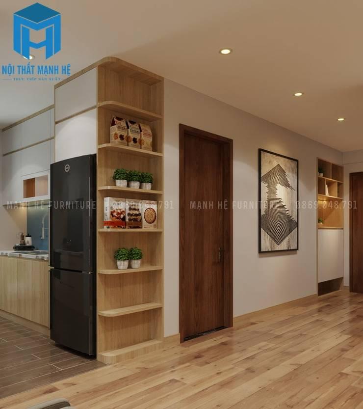 Không gian của căn hộ khá rộng rãi khi được bố trí các vật dụng trang trí nội thất một cách thông minh:  Hành lang by Công ty TNHH Nội Thất Mạnh Hệ