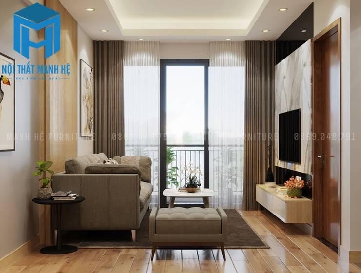Bộ ghế sofa nệm chân gỗ khá nhỏ nhắn :  Phòng khách by Công ty TNHH Nội Thất Mạnh Hệ