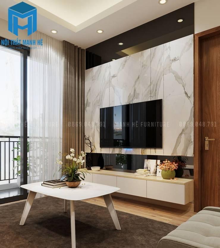 Kệ tivi khá nhỏ nhắn, phù hợp với khoảng không gian của căn phòng:  Phòng khách by Công ty TNHH Nội Thất Mạnh Hệ