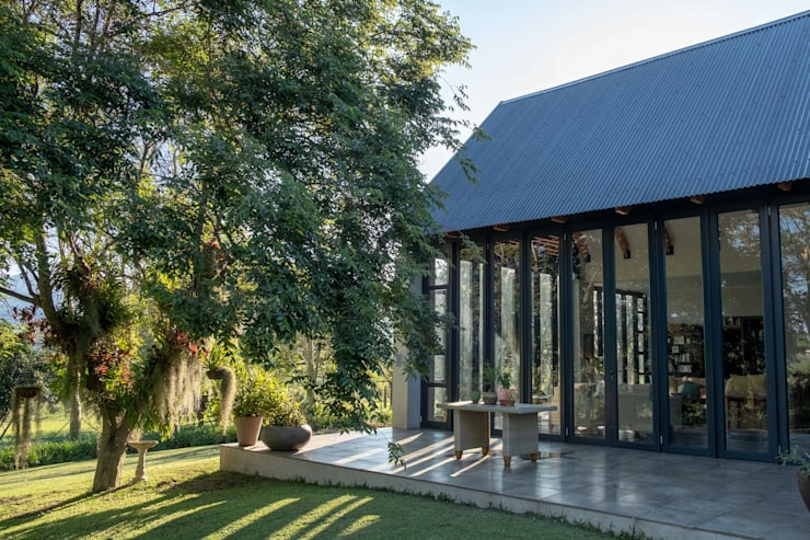 Verandah Extension:  Single family home by ENDesigns Architectural Studio