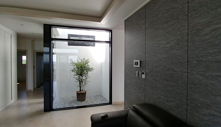 Salas de estilo  por 건축사사무소 지음