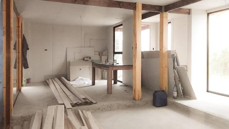 Casa en Punta de Parra, Concepción:  de estilo  por RHA Arquitectura + Construcción