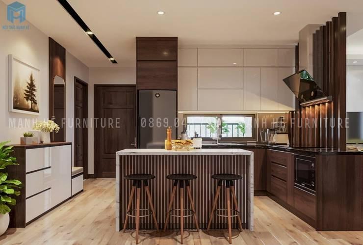 Không gian phòng bếp được thiết kế thêm quầy bar nhỏ rất hiện đại:  Phòng ăn by Công ty TNHH Nội Thất Mạnh Hệ