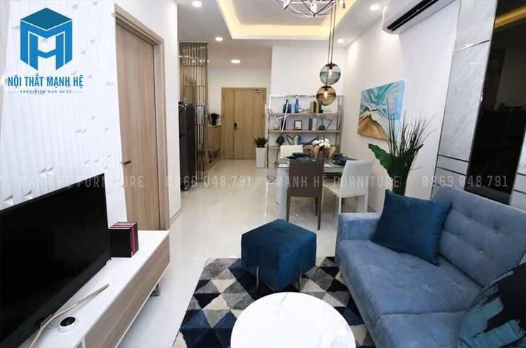 Thiết kế nội thất phòng khách liền kề phòng bếp:  Phòng khách by Công ty TNHH Nội Thất Mạnh Hệ