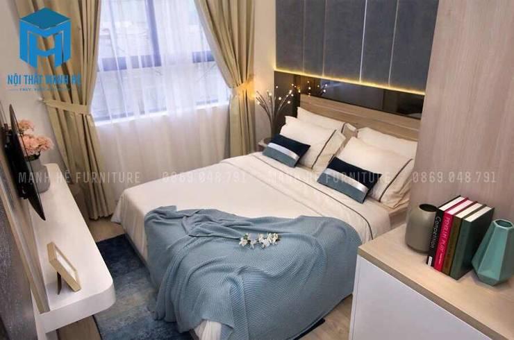 Phòng ngủ nhỏ khá đơn giản và tiện ích:  Phòng ngủ by Công ty TNHH Nội Thất Mạnh Hệ