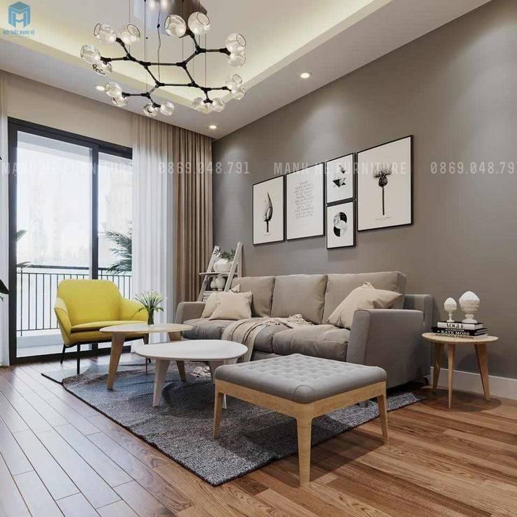 Phòng khách được trang trí bởi gam màu chủ đạo là xám khá tinh tế và hiện đại:  Phòng khách by Công ty TNHH Nội Thất Mạnh Hệ